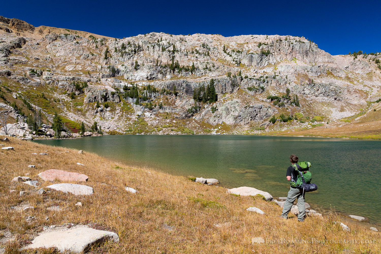 Hiker at Glacial Lake
