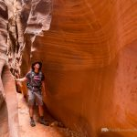 Hiker Admiring Slot Canyon