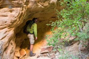 Hiker in Sandstone Alcove