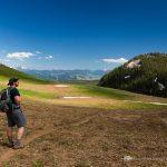 Hiker in Large Alpine Meadow