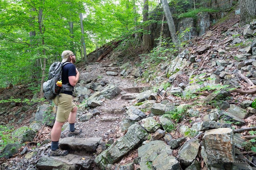 Hiker Climbing Rocky Steps